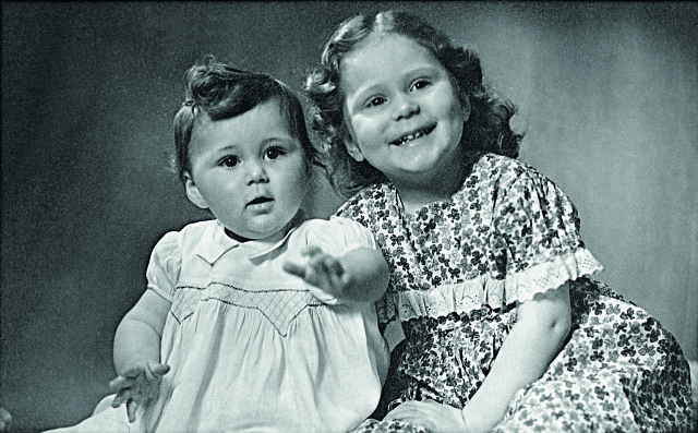 Morpeth (right) and younger sister Caroline in 1950