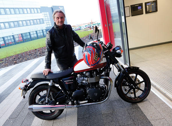Carl Fogarty with his Triumph motorcycle at the college