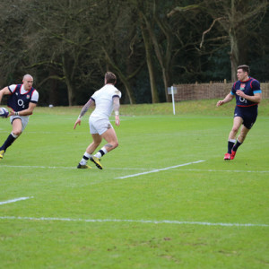 Hartpury RFC winger Jonas Mikalcius, aged 21, (right) goes head-to-head with England national full-back, Mike Brown (left)