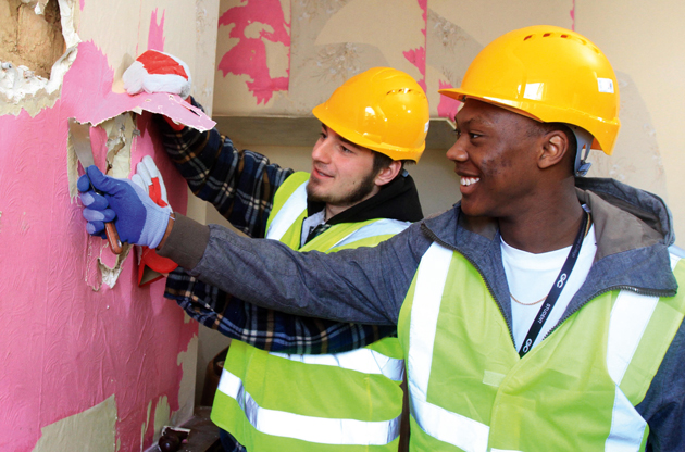 AT WORK: Gloucestershire College students stripping a wall at the house. From left: level two carpentry students Harry Dibden, aged 18, and Juwan Tinnie, 17