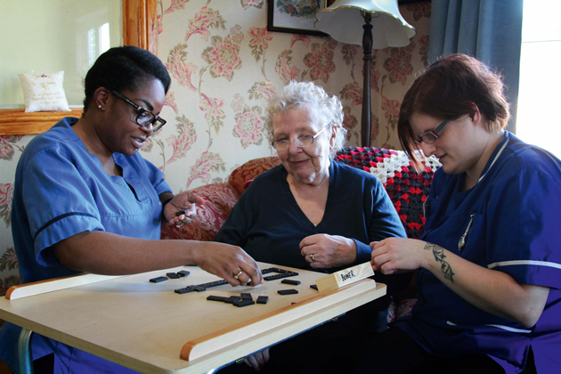 CARING STAFF: Redcar and Cleveland College apprenticeship students Daria Ashton, left, aged 31, and Julia Duncan, right, 36, care for resident of Abbey Care Village, 90 year-old June Stephenson
