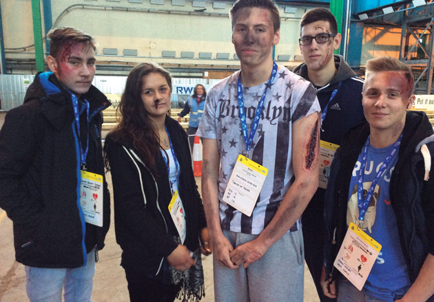 From left: students Liam Brown, aged 16, Leah Warman, 17, Daniel Read, 19, Paulius Kiausinis, 19, and Luke Hunt, 17, just after their make-up had been applied showing various injuries