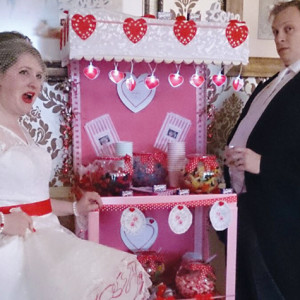 The bride and groom enjoy the sweet trolley at their wedding