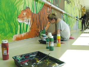 Samantha Clark working on the tiger painting