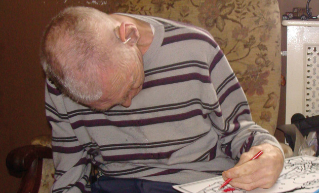 Neil's dad, Samuel, colouring at his nursing home