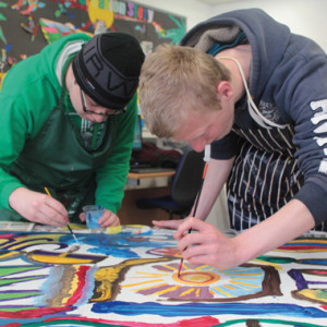From left: students Hassan Hussain,, 17 and Jimmy Jenkins, 18, working on the Tunisian Collaborative Paintings