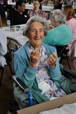 Nursing home resident Doris Russell shows off her newly painted nails