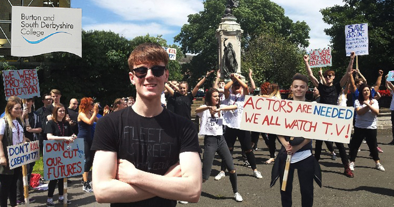 Student protestors celebrate after performing arts courses saved
