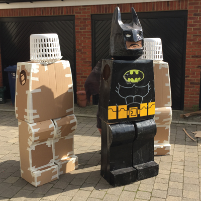 Cardboard and laundry baskets make the perfect superhero