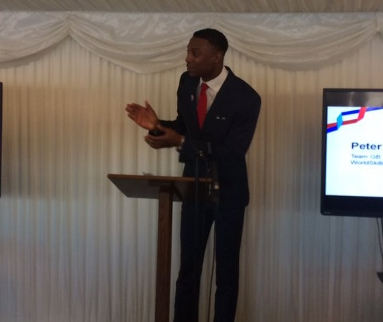 Peter Bakare on stage at the Team UK send off event in parliament