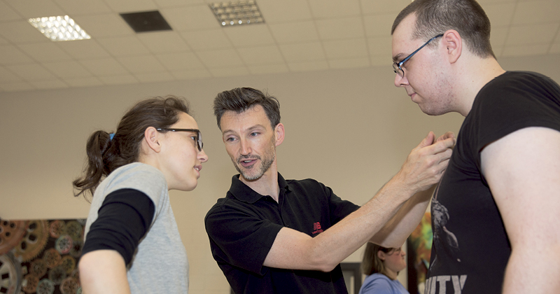 Fighting in class encouraged during stage combat workshop with leading stage fight director