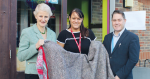 College staff and students stitch blankets out of utility covers for the homeless