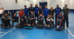 Students take on premier league footballers in a game of powerchair football