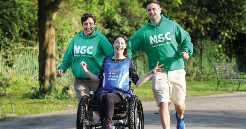 College staff help cerebral palsy student complete marathon