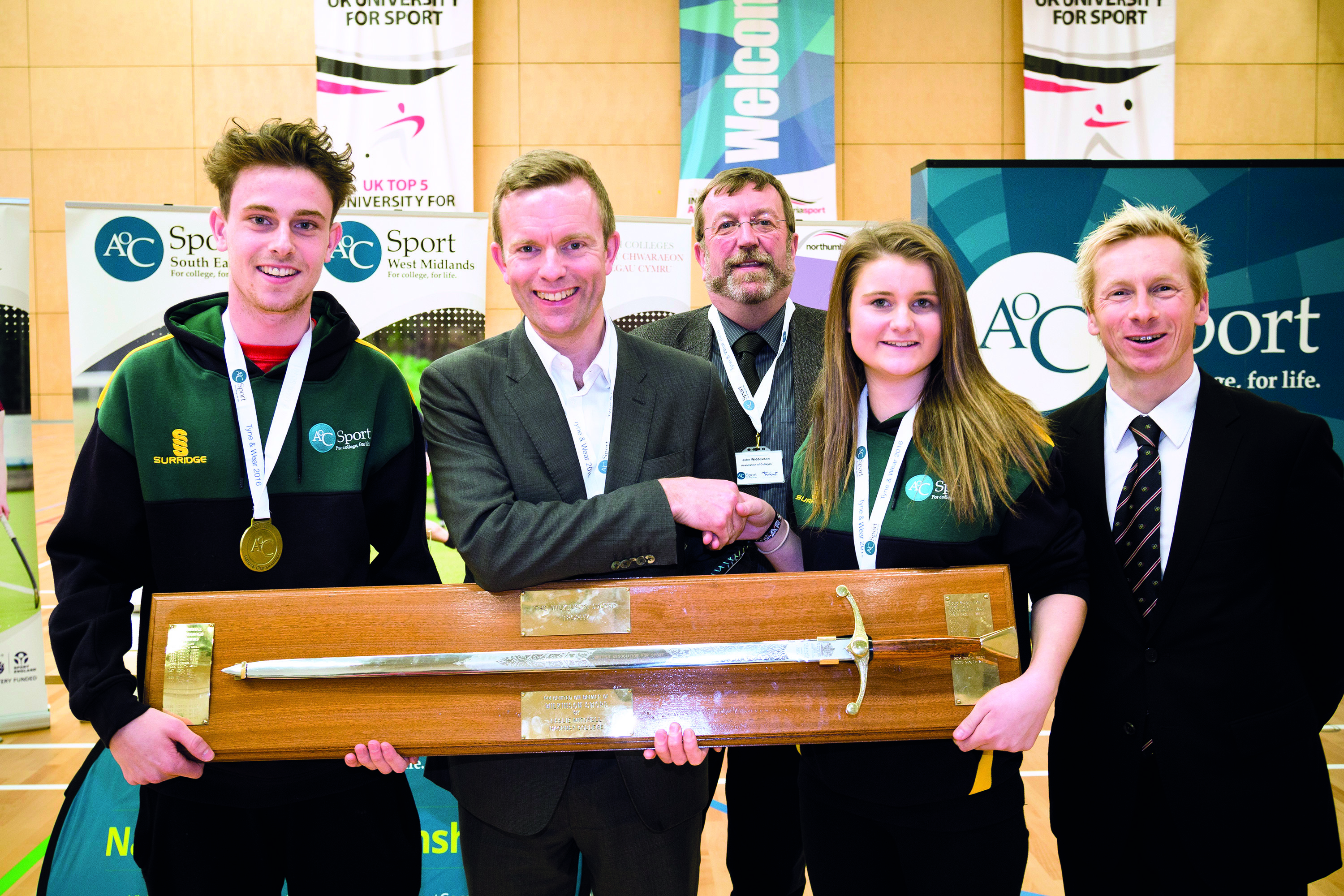 Team South West captains collecting the Wilkinson Sword at AoC Sport National Championships 2016