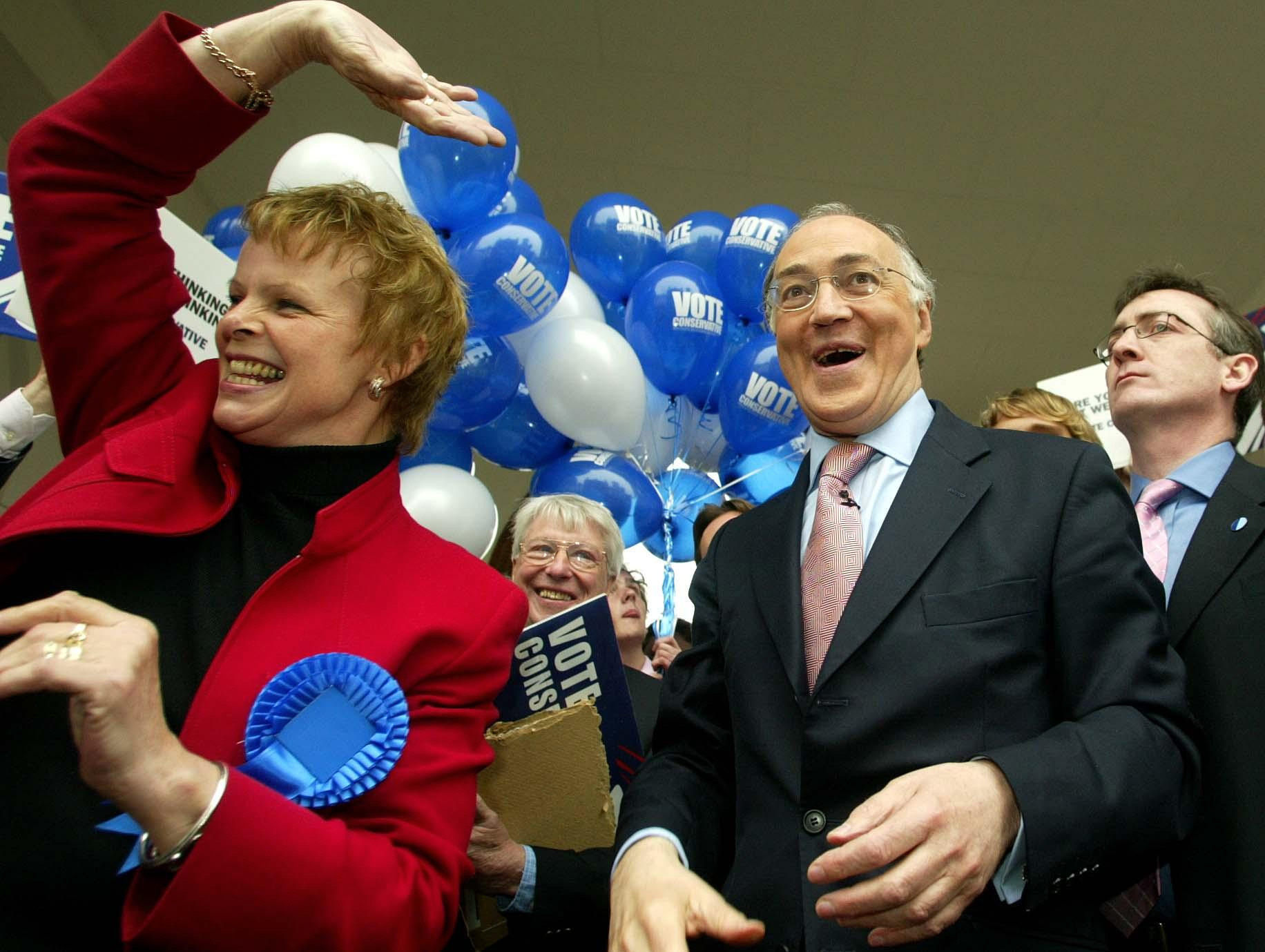 Former Conservative leader Michael Howard and Anne Milton during the last day of campaigning for the 2005 general election