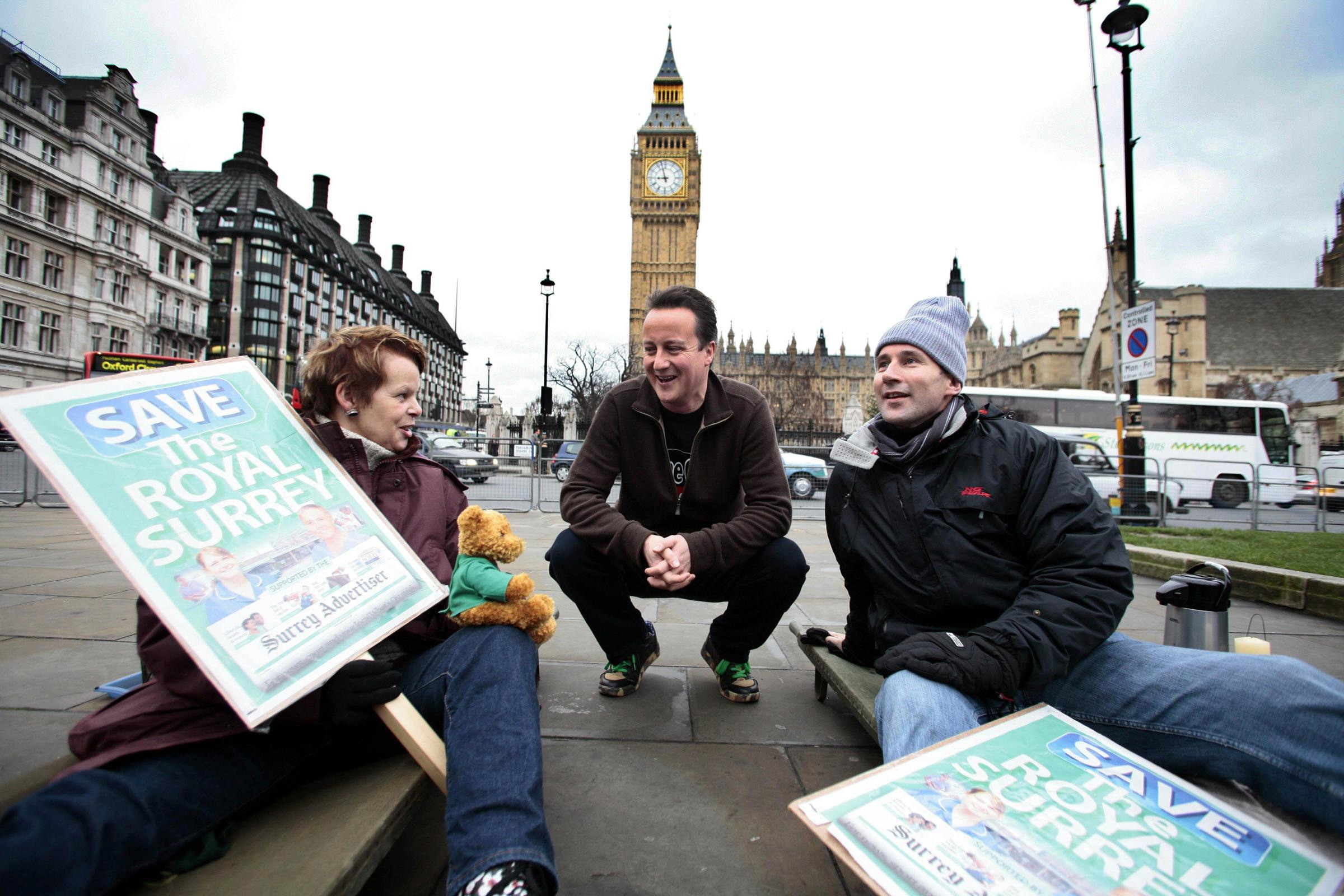 David Cameron meets Anne Milton and health secretary Jeremy Hunt MP in Parliament Square, after they stayed out all night for the campaign to save the Royal Surrey Hospital