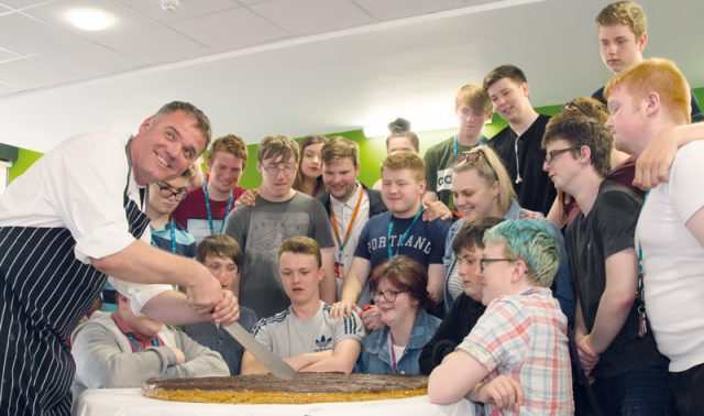 Tutor makes giant millionaire's shortbread to celebrate the end of term