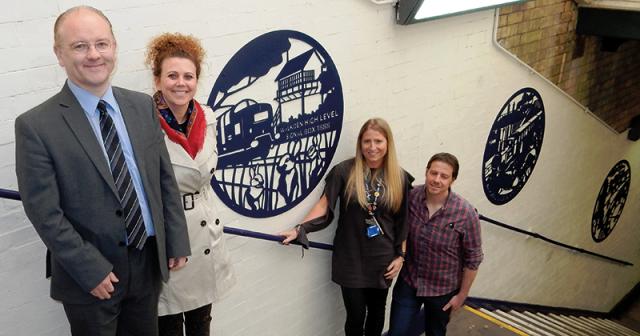 Salford City College students behind new steel artwork at Walkden train station