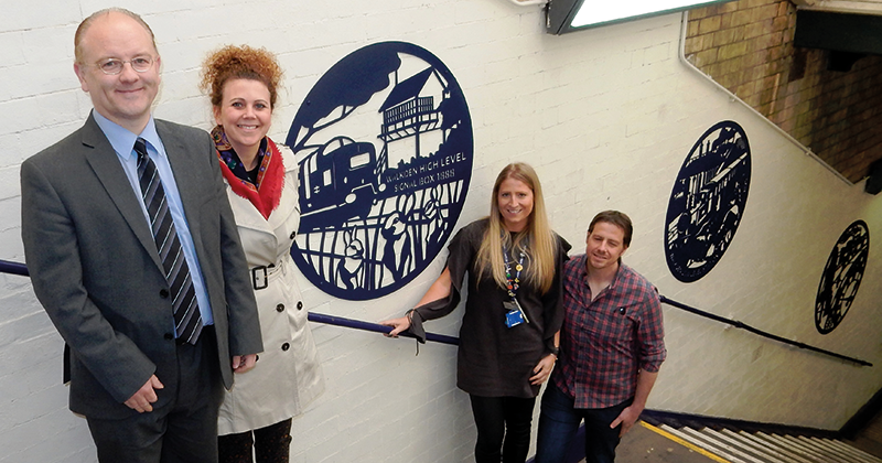 Salford City College students behind new steel artwork at Walkden train station