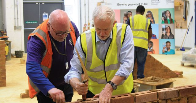 Corbyn tries his hand at bricklaying during college visit