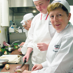 College senior management team take part in cooking challenge
