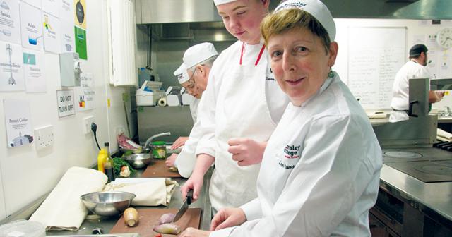 College senior management team take part in cooking challenge
