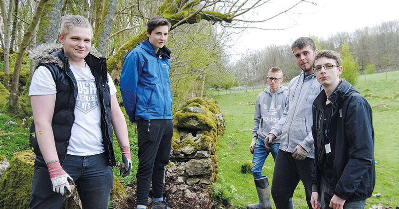 Brickwork students work on restoring medieval dry stone walling